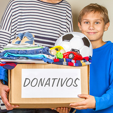 Donation Concept. Donate Box With Clothes, Books And Toys In Chi